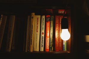 White LED shines on a stack of books